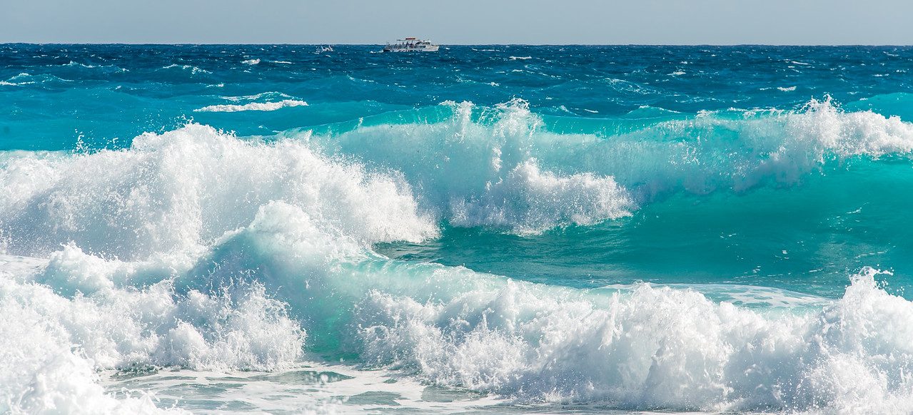 Dive boat in rough surf, Cancun, Mexico - December 2015