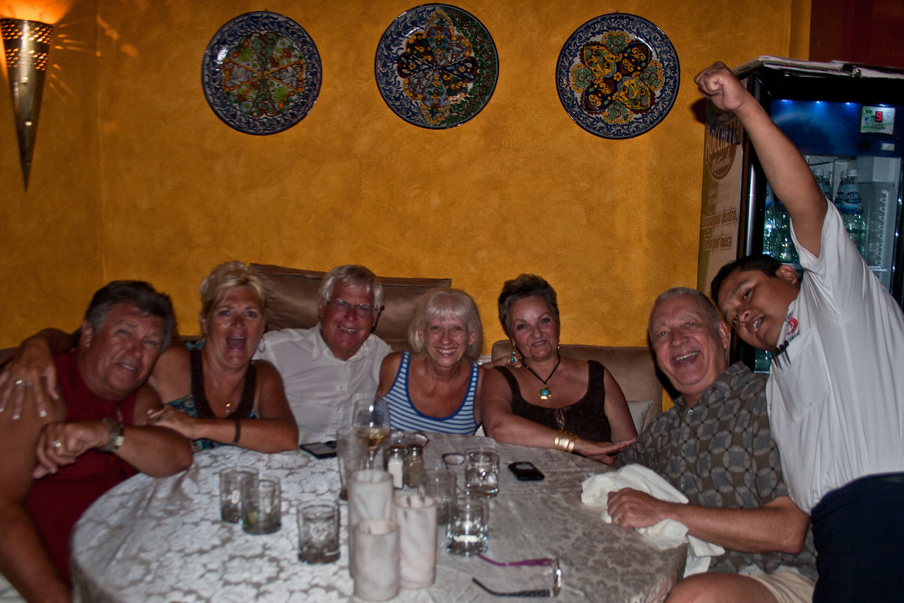 Wayne and Sande Anderson, Larry and Carole Boshell, Marie and Daryl Forrest and waiter.