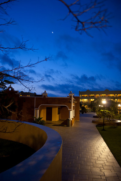 Sunrise, OK, moon view, early morning from courtyard of  Royal Hacienda resort.