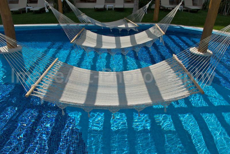 Hammocks over a pool