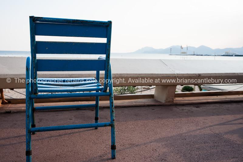 Cahracteristic blue chair on walkway of la Croisette, Cannes, Cote d'Azur.