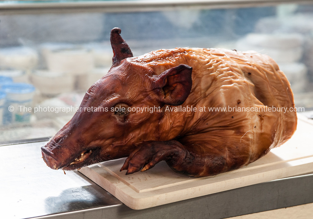 Pig head, cooked and on display at Mrche Provencal, Antibe Market in south of France.