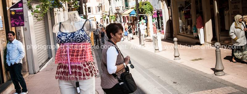 Street scene, Antibes, manekin displayng womens clothes.