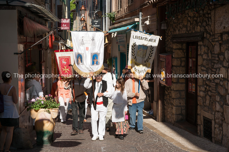 Antibes, Cote d'Azur. May Day, 1st May parade through the narrow streets of Antibes, Cote d'Azur, France. Model Release; NO, for personal & editorial use.