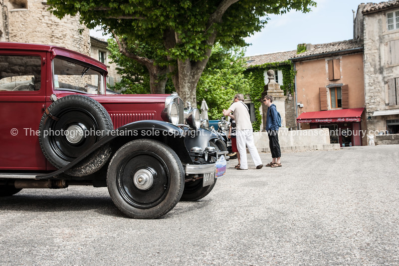 vintage cars and people in square, Gordes, Cote d'Azur.