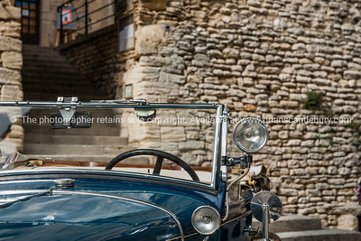 vintage cars and people in square, Gordes, Cote d'Azur..