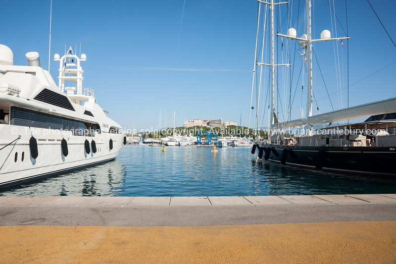 Super-yachts in Antibes, Cote d'Azur.<br /> Antibes has the largest yacht marina on the Côte d'Azur, built in the 1960s on the site of a Roman harbor.