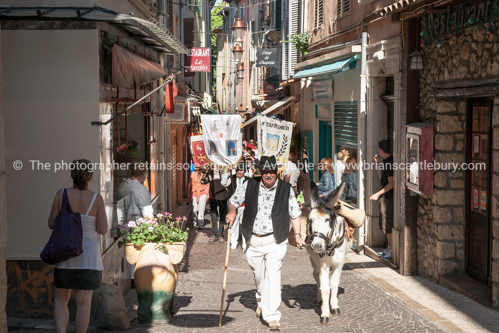 May Day, 1st May parade through the narrow streets of Antibes, Cote d'Azur, France.<br /> Model Release; NO, for personal & editorial use.