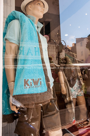 Kiwi logo ongarment in shop window, Antibes, France.