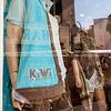 Kiwi logo ongarment in shop window, Antibes, France.