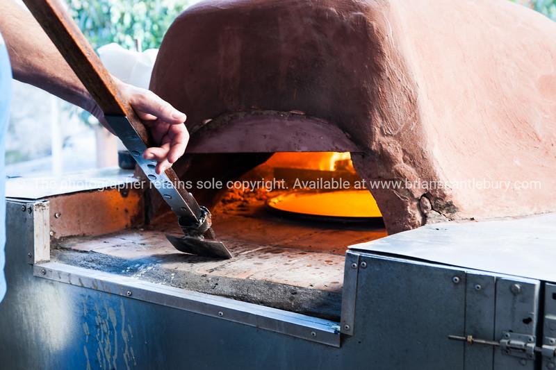 Cooking pizza at Antibes markets, Cote d'Azur.<br /> Marche Provencale.