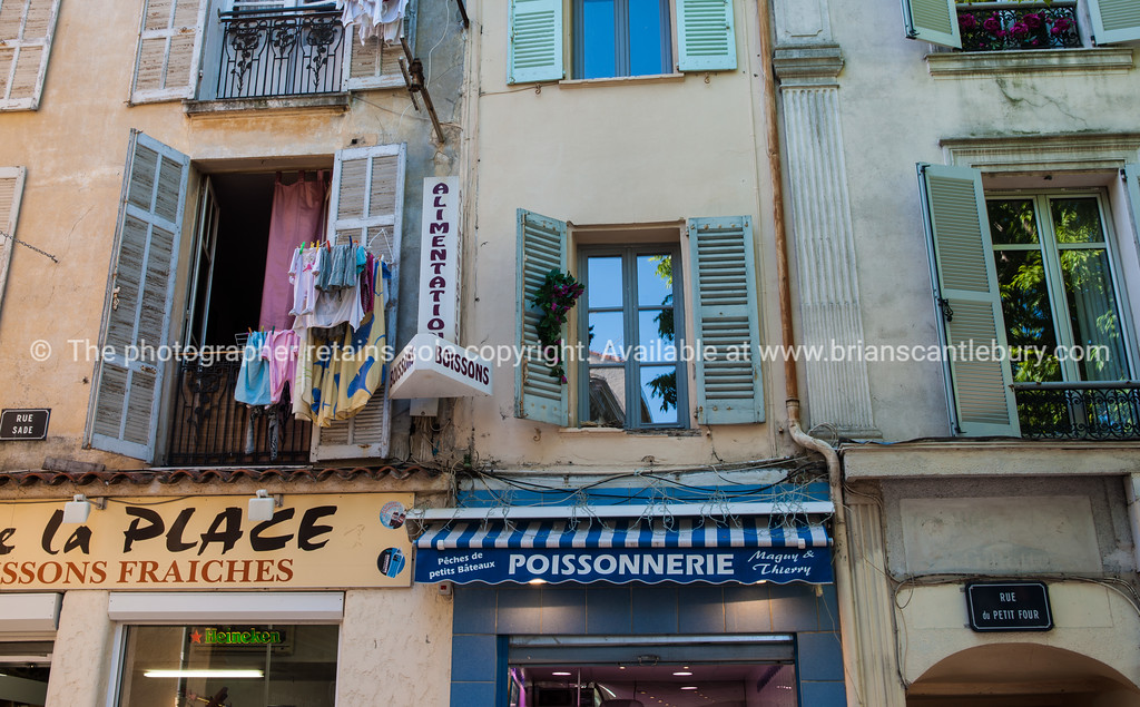 Poissonnerie,with apartments above and washing hanging,  Rue Sade, Antibes, Cote d'Azur.