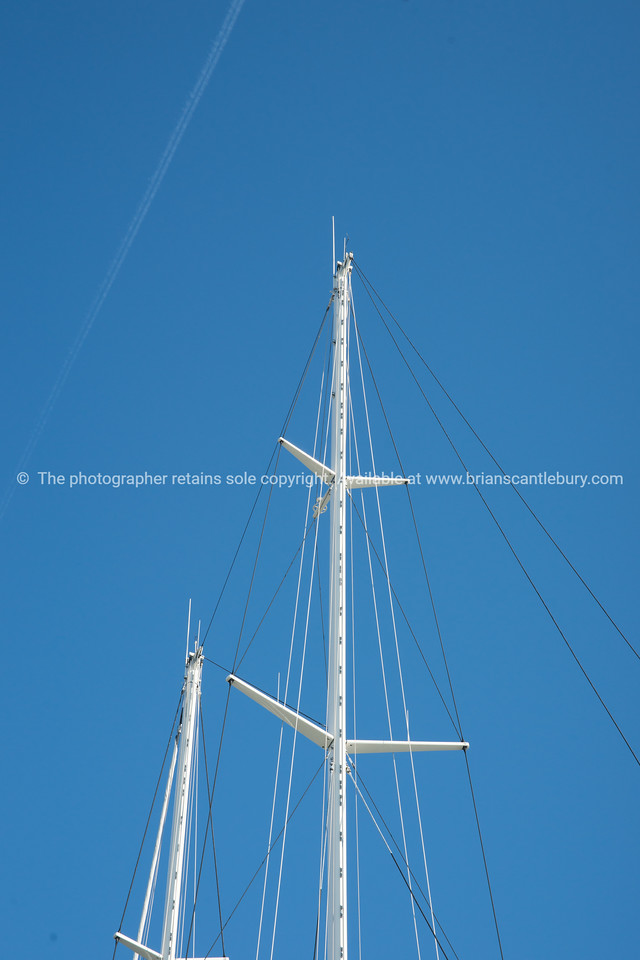 Super-yachts masts isolated against blue sky, in Antibes, Cote d'Azur.