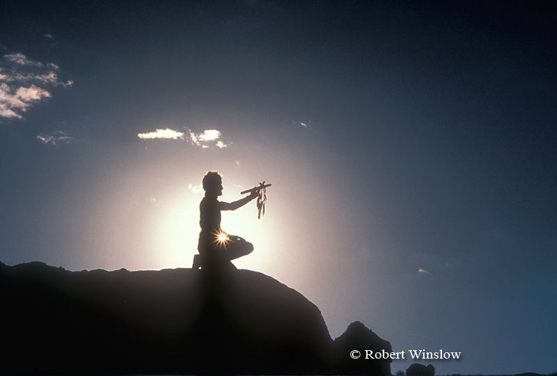 Model Released, Silhouette, Man Holding Peace Pipe or Talking Staff or Ceremonial Staff, Canyon Country, Canyonlands National Park, Souteastern Utah, USA, North America