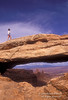 Model Released, Woman on Mesa Arch, Island in the Sky District, Canyonlands National Park, Utah, United States, North America