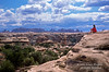 Model Released, Woman overlooking The Needles District, Canyonlands National Park, Utah, USA, North America