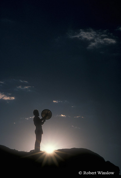 Model Released, Silhouette, Man beating Drum, Canyon Country, Canyonlands National Park, Souteastern Utah, USA, North America