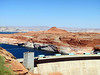 Glen Canyon Dam.  That body of water is Lake Powell, a reservoir formed from the Colorado river by the dam.