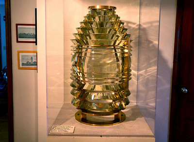 A vintage fourth order Fresnel lens, used in lighthouses, on display in the Highland Lighthouse visitor Center. The size of the lens is the primary factor in determining the order, ranging from first (the smallest) to sixth order, a man-sized giant of carefully formed glass.