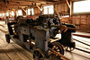 Mystic Seaport. This 250 foot- long factory was originally part of a rope factory that was over 1000 feet in length. These dollies roll along the floor and spin the many spools of twine into a huge, one piece rope.