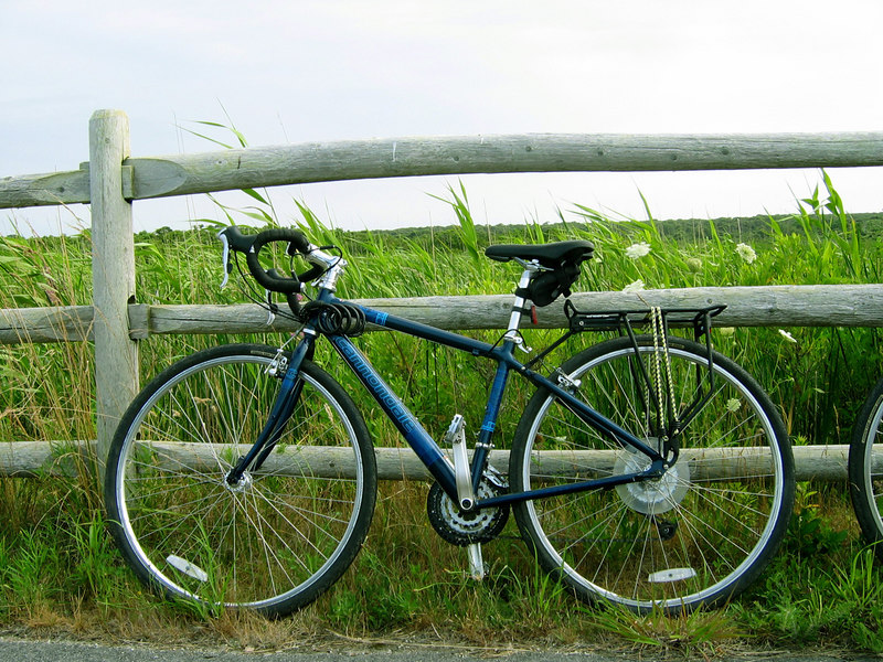 Michelle's bike leaning against a fence, Nantucket, MA.
