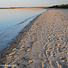 Footprints in the sand a little before sunset, on Veterans Park Beach, Hyannis, Cape Cod, Massachusetts