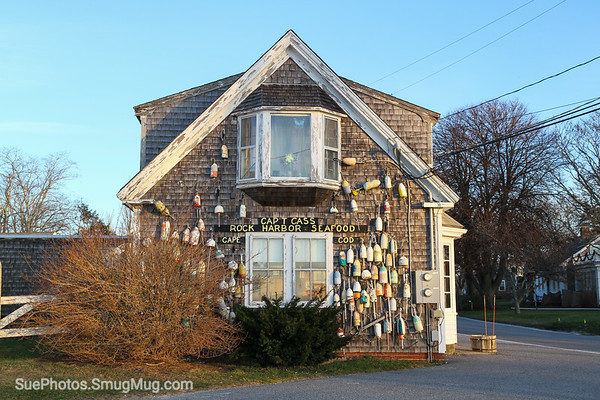 An old, weathered building housing a seafood restaurant, Orleans, Cape Cod, Massachusetts, United States, North America