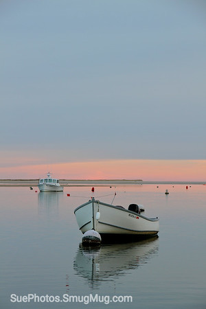 A boat at sunset near Chatham Fish Pier. Chatham, Cape Cod, Massachsuetts