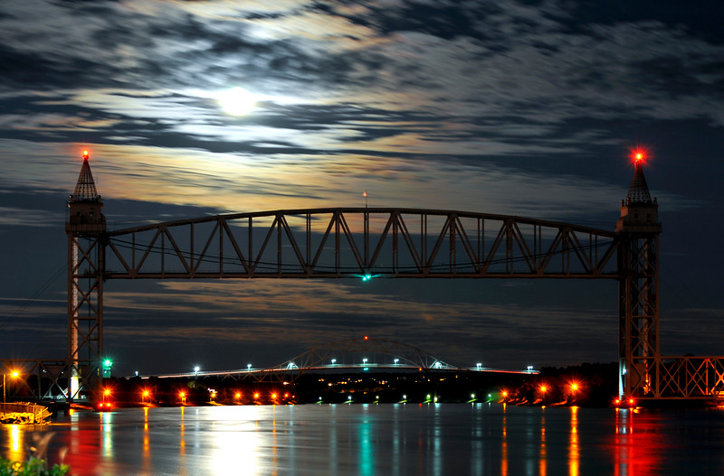 2009-13333 copy. Cape Cod Canal under a full moon. The near bridge is a Rail Road bridge, the far bridge is the Bourne Bridge.