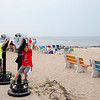 Kids play around on viewing scopes at Sunset Beach at the Southernmost point of Cape May