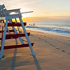 Dawn on the beach of Cape May.  An empty lifeguard chair awaits the day's activities