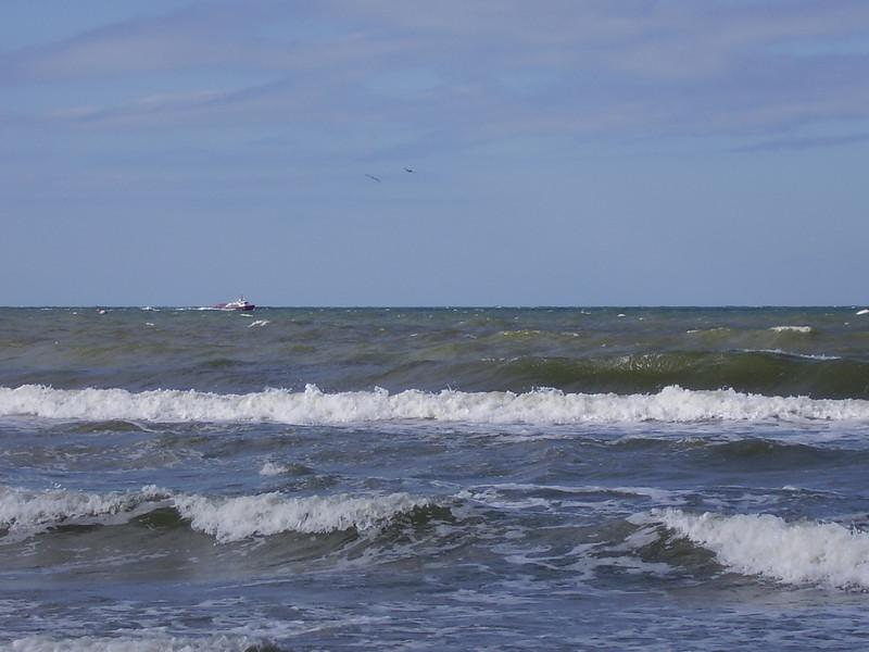 A fishing boat in the choppy sea.