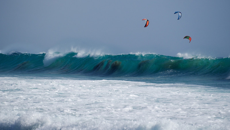 Huge waves, clear Atlantic waters (22C) & lots of wind make for a windsurfing paradise. I had to double take when I first saw the dark shapes within the breaking waves :-)