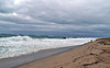 Low clouds, high surf and wicked wind.