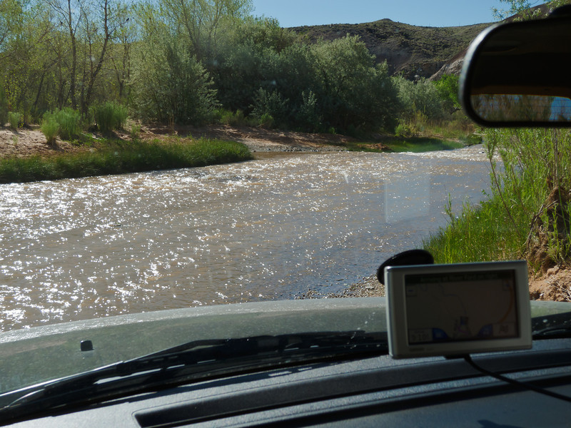 Ready to ford  the Fremont River in a Jeep at the start of the Cathedral Valley 60 mile all-day back road loop in Capital Reef National Park.