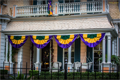 Typical porches adorned with Mardi Gras colors.