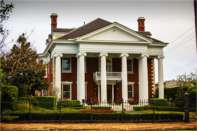 Swaying along St. Charles Avenue through a tunnel of Live Oak trees, the streetcar passes dozens of antebellum mansions, historic monuments, Loyola and Tulane universities.