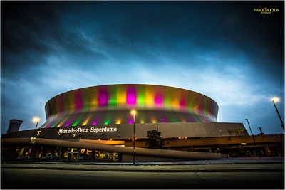 The Mercedes Benz Superdome is arrayed with colored lights in preparation for Mardis Gras.