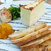 Currents Restaurant at the Riverhouse<br /> Rogue Smokey Blue Cheese Cake - roasted garlic, pear chutney, baby arugula, crostini