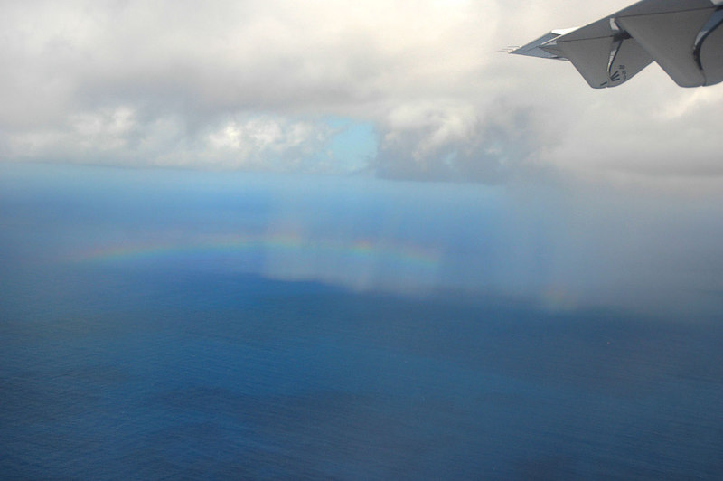 A rainbow appears as we descend below the clouds.