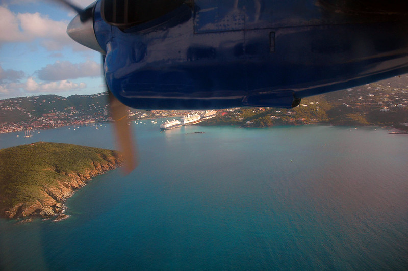 The plane descending for a landing in St Thomas Harbor.