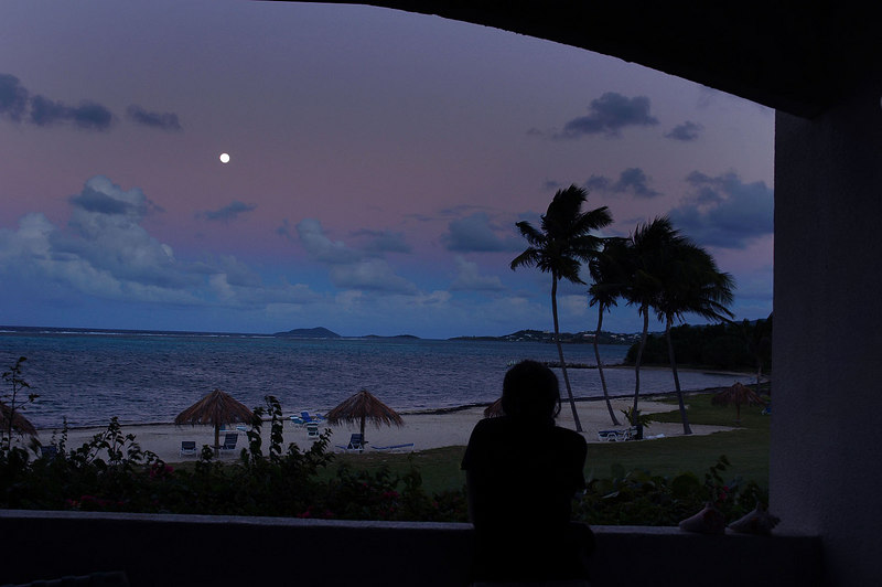 Thao looking out at the beach by moon light from the patio.