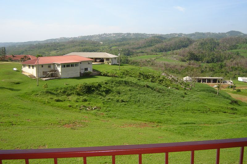 View of the dining hall and missionary housing at the Jamaica Deaf Village from the third floor walkway.