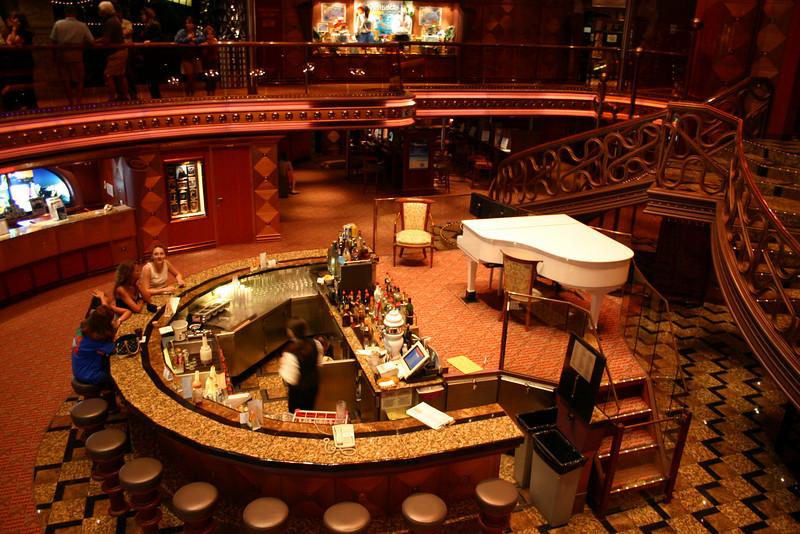 Carnival Elation - Atrium Bar Deck 7, at the base of the Grand Atrium.