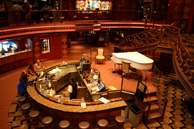 Carnival Elation - Atrium Bar Deck 7, at the base of the Grand Atrium.