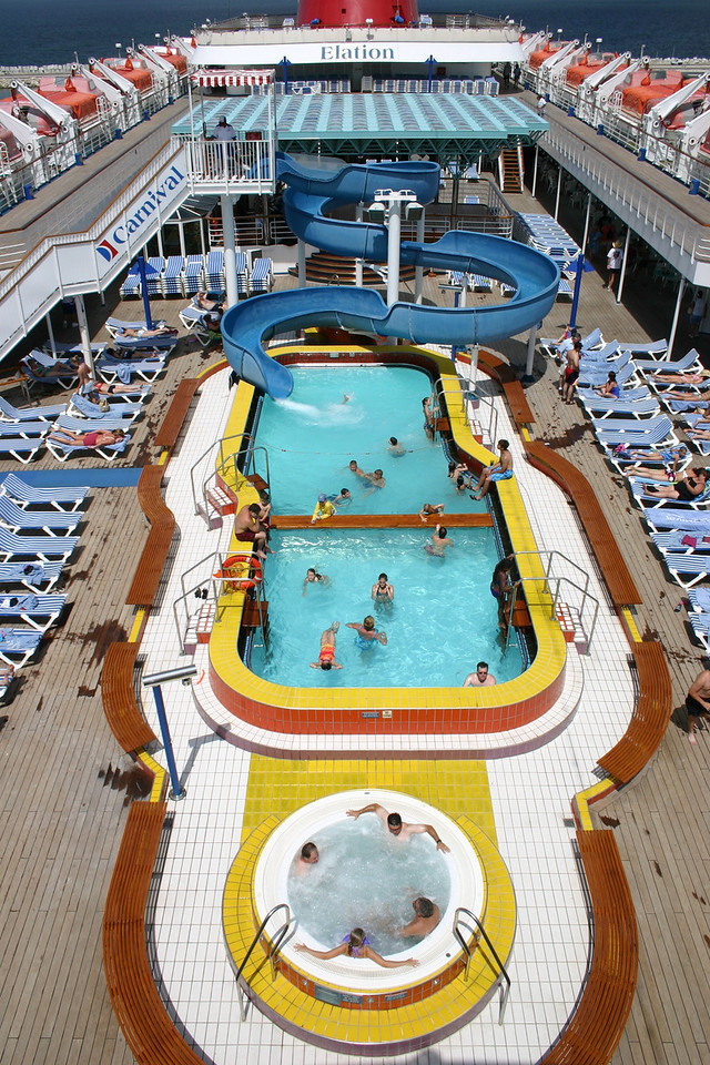 Carnival Elation - Main Pool The main pool, with waterslide, is on Lido deck, aka deck 10. There is a whirlpool at each end of the pool, and one is reserved for adults only.
