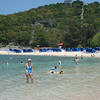 Raye cools her feet in the Caribbean water at Labadee.