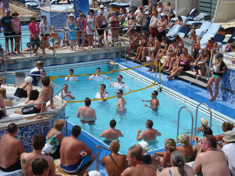 Officers take on guests in pool volley ball competition.