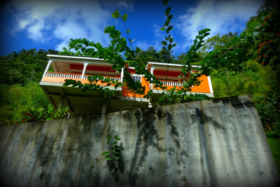 colorful house perched on a hillside