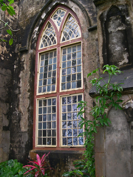 Old faded paint and stained walls of old church - Barbados
